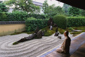 ca. 1990s, Kyoto, Japan --- A Buddhist monk meditate beside a Zen rock garden at the Zuiho-in inside the Daitokuji Temple complex of Kyoto. --- Image by © Catherine Karnow/Corbis